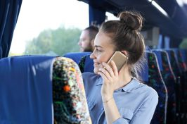 Passenger speaks on the phone while traveling.